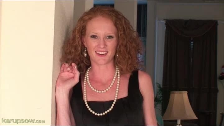 Mature redhead strips off her black dress