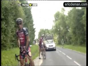 Cyclist pissing on tour de france