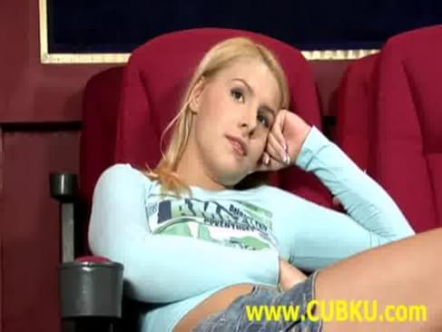 Very hot young teen sitting in the cinema and fingering pussy