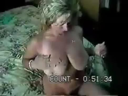 A horny milf gets fucked on her mom and dads bed