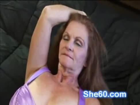 Horny granny redhead fucks her shaved pussy with a dildo on her couch. Her younger husband comes in and makes her blow his big hard cock. The slut lies down on the couch and has her cunt eaten by him.