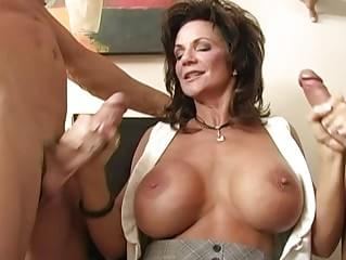 Busty brunette milf gangbanged by two hug cocks getting licked and sucking cocks