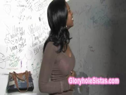 Horny busty black Jordan Love goes slutty in the restroom. She was fingering her cunt when a big white dick shows up. That sneaky big cock is pointing at her through the gloryhole, so all what she has