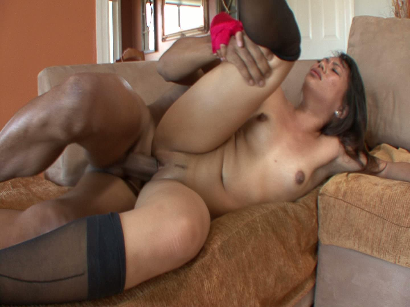 This horny Asian girl sucks on his big black rod and then gets it jammed in her pussy in this free tube video.