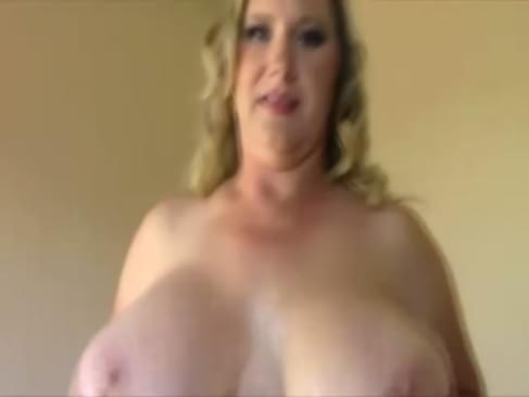 Busty MILF loves her big tits and pussy and plays with them both before tugging cock