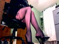 Femdom in heels and pantyhose teases with a leather paddle