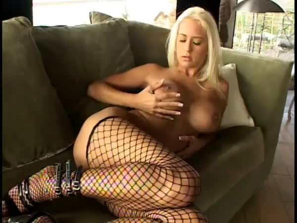 This busty blonde likes to lick her big tits while she finger fuck her hot beaver hole until she cums