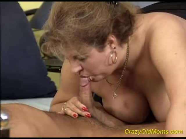 Mother feeling her daughters breasts