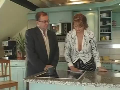 Mature redhead fucked in kitchen