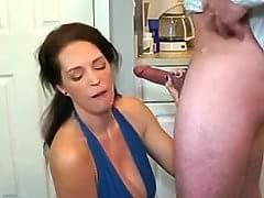 Mature woman sucks cock