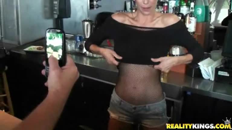 Barmaid with huge round tits