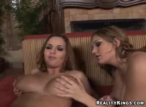 Sucking and pressing her big boobs nipples in videoclips