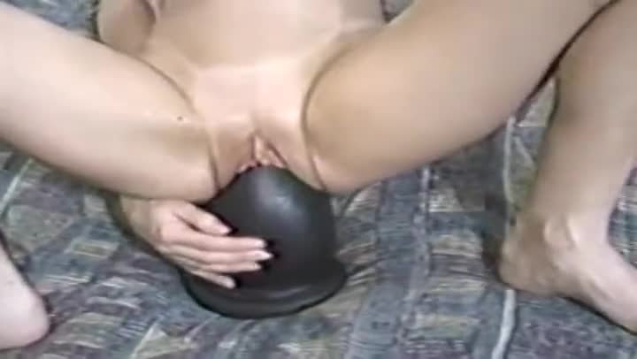 Virgin sits on a huge dildo