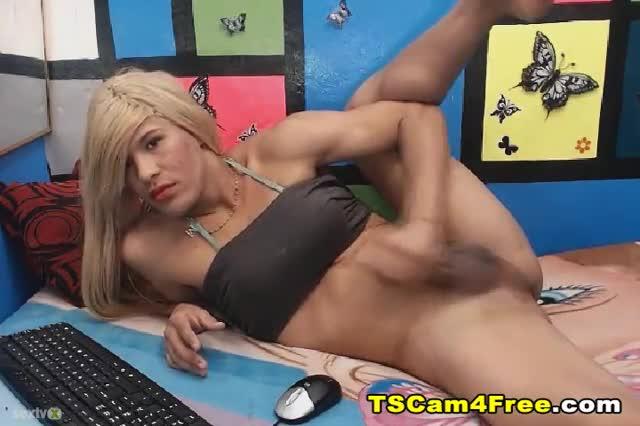 Blonde asian tranny wanks huge cock