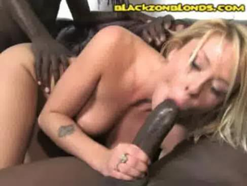Blonde babe crouches and sucks a couple huge black cocks before bending over ...