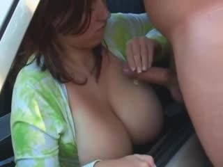 busty handjob in a car