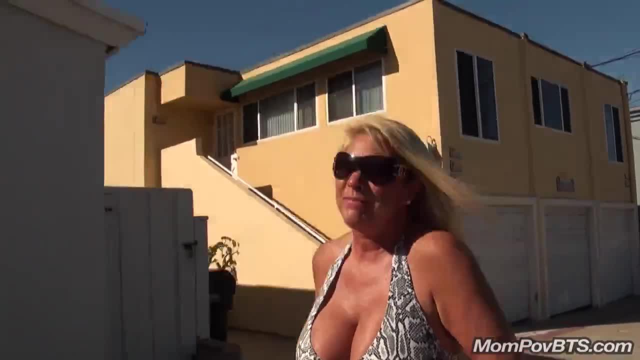 Busty blonde milf public beach flashing