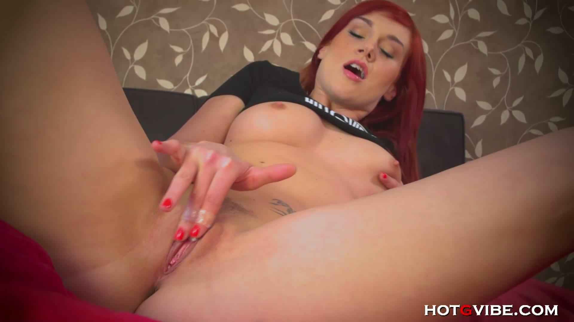 Busty red head masturbating