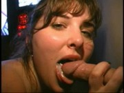 charlee in an adult theatershe is blowing dicks through a gloryhole in an ...