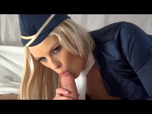 Flight attendant gives blowjob