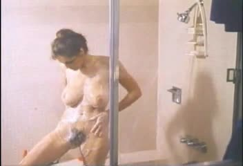 Hairy mature showers and gets dressed (vintage)