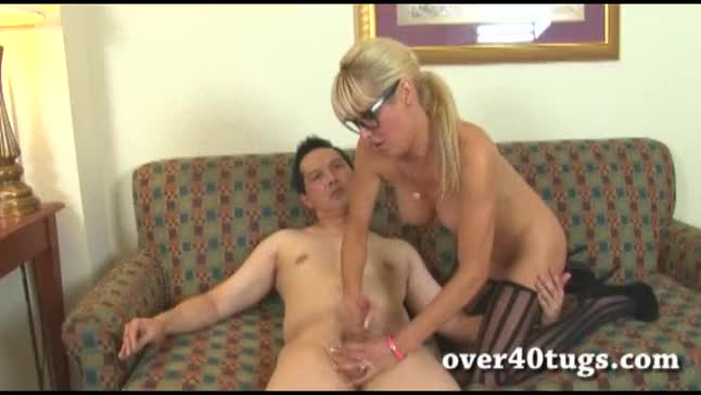 Milf giving hand job