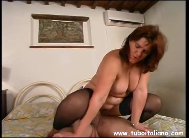 Big breasted woman having sex