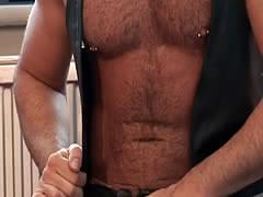 Nipplepierced bear masturbates with toy