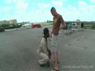 Outdoor interracial blowjob with gay studs