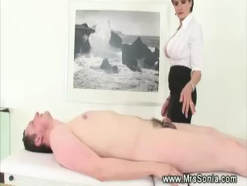 Prodomme working her slaves cock before facesitting at her desire