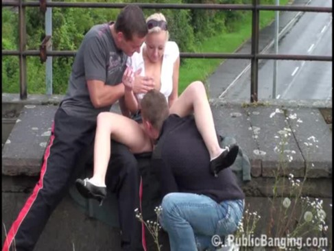 a pretty girl and two guys having public sex on a rainy day very nice