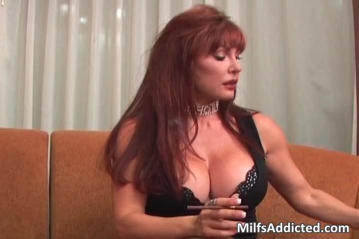 Redhead masturbates on bed