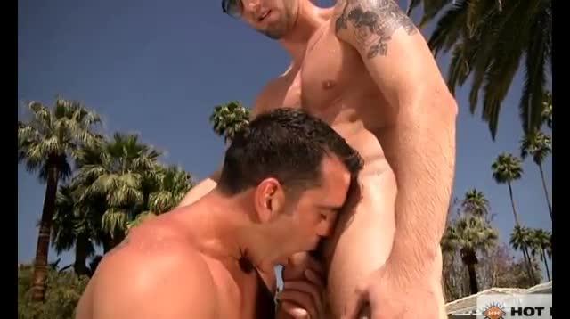 Tattooed gay giving head