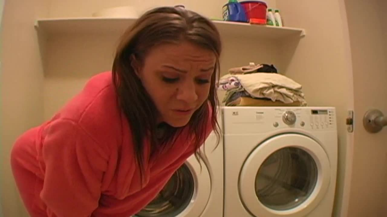 Girl using washng machine to masturbate