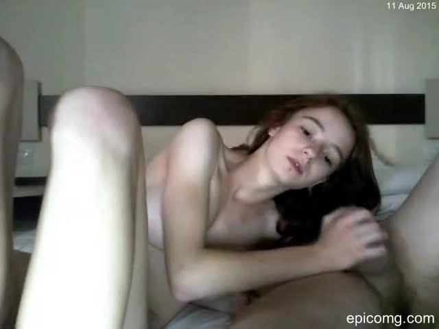 A naked girl using a shower massager