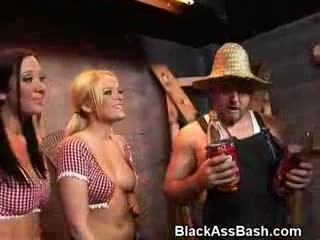 Two white country bitches with onion asses usually reserved for ghetto trash black girls tag team sucking cock in the barn.