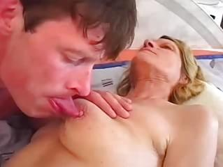 George is staying over at his friends house one day when he hears some soft moaning coming from the upstairs bedroom. Lurking on the other side of the closed bedroom door, he can hear the moaning getting louder, along with some soft slapping and slurping noises. Bursting into the room, he sees his friends mom, skinny blond MILF Hana, masturbating with a large toy! Hana covers her embarrassment by beckoning to the young stud, who is rock hard at the sight of the masturbating mature slut, des